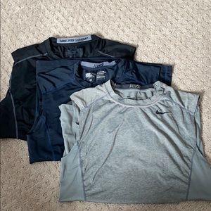 Nike Sleeveless Pro Combat workout shirts